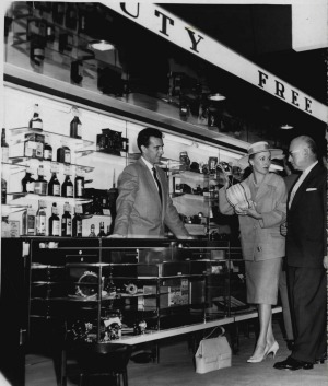A passenger makes a purchase at the Mascot Duty Free store in 1961. The good old days of saving a lot on duty free ...
