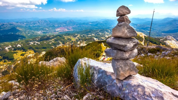 Small piles of rocks like this can be found on hiking trails all over the world. But what are they called?