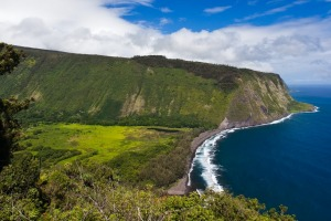 Waipi'o Valley is a hidden tropical paradise surrounded by sheer cliffs and coast.