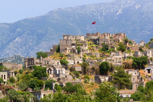 KAYAKOY, TURKEY. Spilling down a hillside near Turkey's south-west coast, Kayakoy once had a population of 6500 ethnic ...