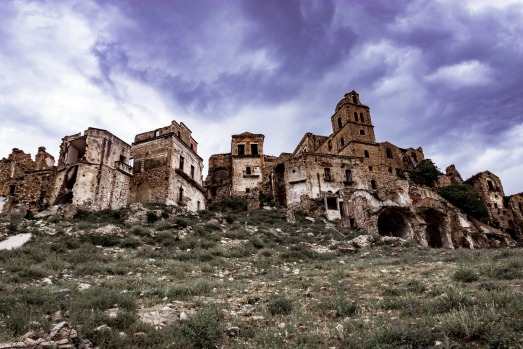 CRACO, ITALY. Stepping dramatically up a hilltop in the Basilicata region of southern Italy, this medieval village and ...