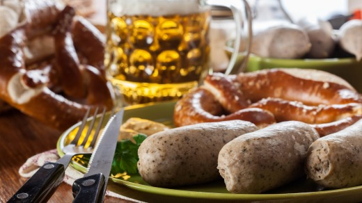 Bavarian breakfast with white sausage, pretzel and beer.