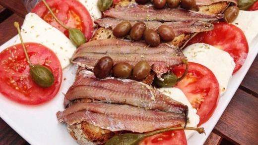 Fresh, salty anchovies served on woodfired crusty bread with a squeeze of lemon juice.