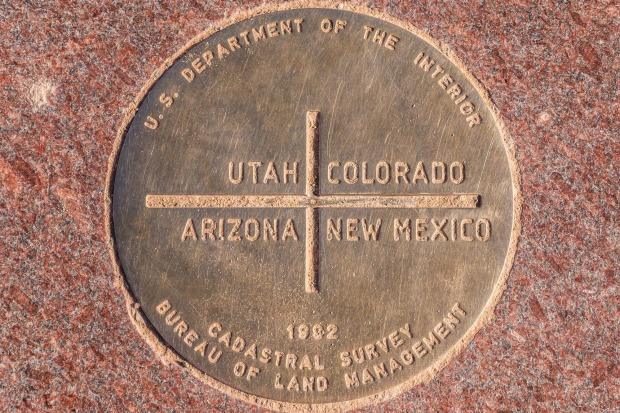 Four Corners Monument: Alas, it's little more than a big circle on the ground. Monument Valley, on the Utah – Arizona ...