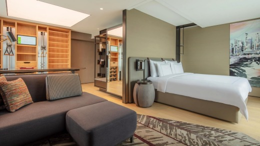 Swissotel The Stamford's Vitality Rooms feature an in-room yoga station and a wellness wall.