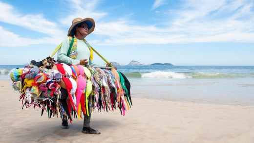A beach vendor sells bikinis on Ipanema Beach.