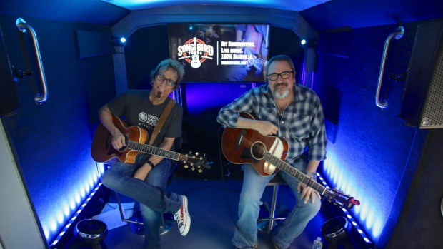 Performers Trey Bruce and Tommy Conners on the live music tour bus.