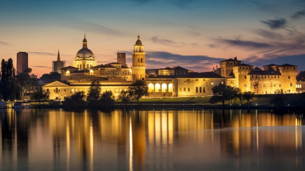 Twilight over Mantova skyline reflected in Lago Inferiore, Lombardy, Italy.