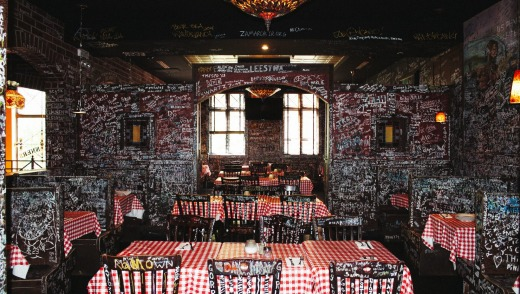 The walls at Gino's East are covered in 50 years' worth of graffiti scrawled by satisfied customers.