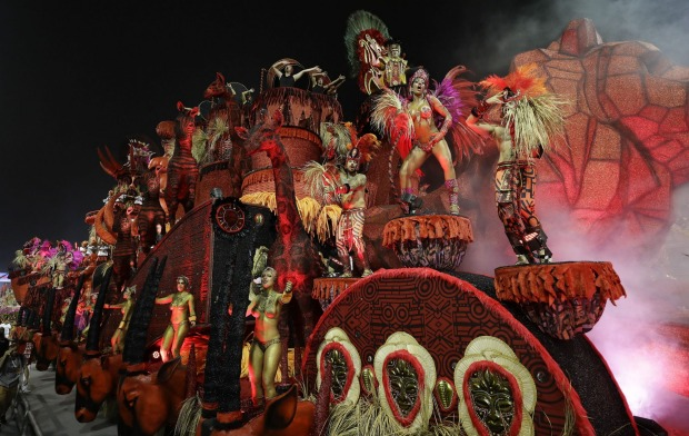 Dancers from the Colorado do Bras samba school perform on a float during a carnival parade in Sao Paulo, Brazil.