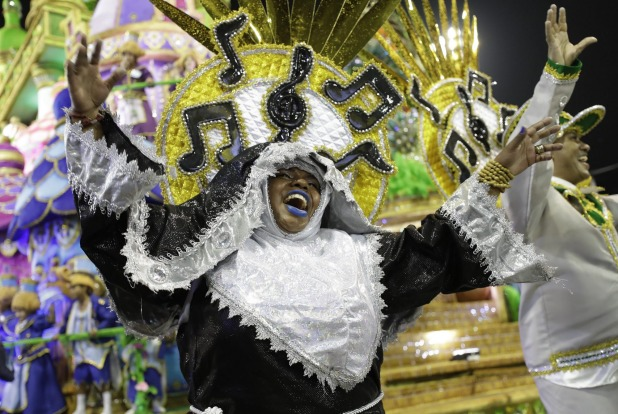 A dancer from the Imperio de Casa Verde samba school performs during a carnival parade in Sao Paulo, Brazil.