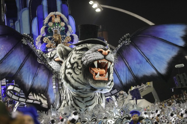 Dancers from the Imperio de Casa Verde samba school perform on a float during a carnival parade in Sao Paulo, Brazil.