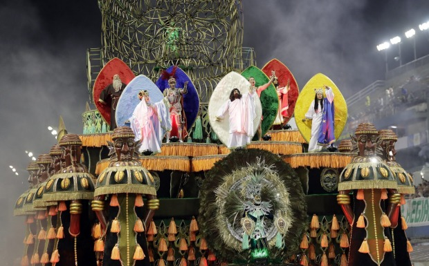 Dancers from the Mancha Verde samba school perform on a float during a carnival parade in Sao Paulo, Brazil.