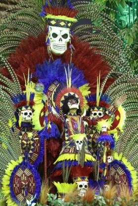 A dancer from the Academicos do Tucuruvi samba school performs on a float during a carnival parade in Sao Paulo, Brazil.