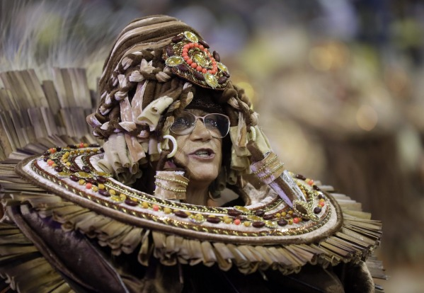 A dancer from the Academicos do Tucuruvi samba school performs during a carnival parade in Sao Paulo, Brazil.