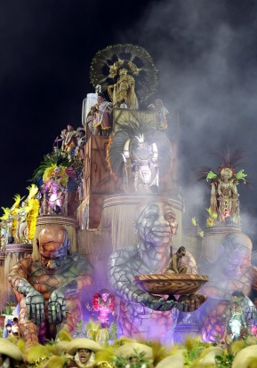 Dancers from the Academicos do Tucuruvi samba school perform on a float during a carnival parade in Sao Paulo, Brazil.
