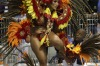 A dancer from the Academicos do Tucuruvi samba school is assisted by a fellow dancer as she performs during a carnival ...
