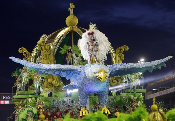 Dancers from the X-9 Paulistana samba school perform on a float during a carnival parade in Sao Paulo, Brazil.
