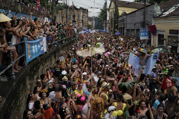 """Revelers perform during the """"Ceu na Terra"""" or Heaven on Earth street party in Rio de Janeiro, Brazil. Much of the appeal ..."""
