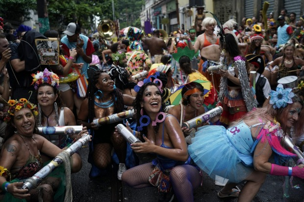 """Revellers perform during the """"Ceu na Terra"""" or Heaven on Earth street party in Rio de Janeiro, Brazil. Much of the ..."""