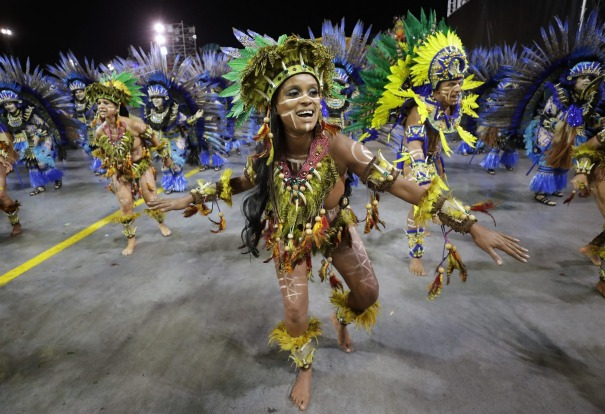 Dancers from the Aguia de Ouro samba school perform during a Carnival parade in Sao Paulo, Brazil.