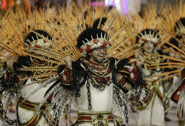 A dancer from the Aguia de Ouro samba school performs during a carnival parade in Sao Paulo, Brazil.