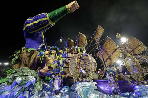 Dancers from the Aguia de Ouro samba school perform on a float during a Carnival parade in Sao Paulo, Brazil.