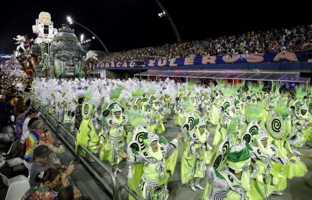 Dancers from the Dragoes da Real samba school perform during a Carnival parade in Sao Paulo, Brazil.