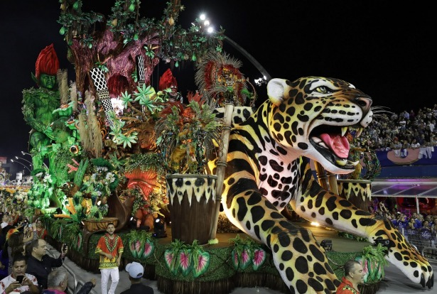 Dancers from the Dragoes da Real samba school perform on a float during a Carnival parade in Sao Paulo, Brazil.