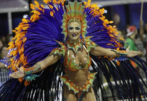 A dancer from the Mocidade Alegre samba school performs during a Carnival parade in Sao Paulo, Brazil.