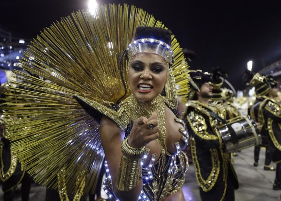 A dancer from the Vai-Vai samba school performs during a carnival parade in Sao Paulo, Brazil, Sunday.