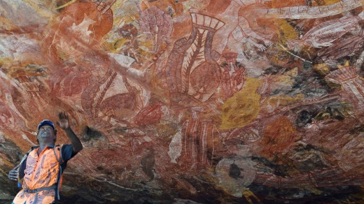 Roland, a guide from the Gunbalanya community explains the rock art Injalak Hill.