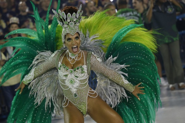 A performer from the Imperio Serrano samba school parades during Carnival celebrations at the sambadrome in Rio de Janeiro.