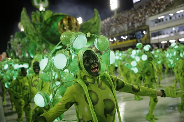 Performers from the Imperio Serrano samba school parade during Carnival celebrations at the sambadrome in Rio de Janeiro.
