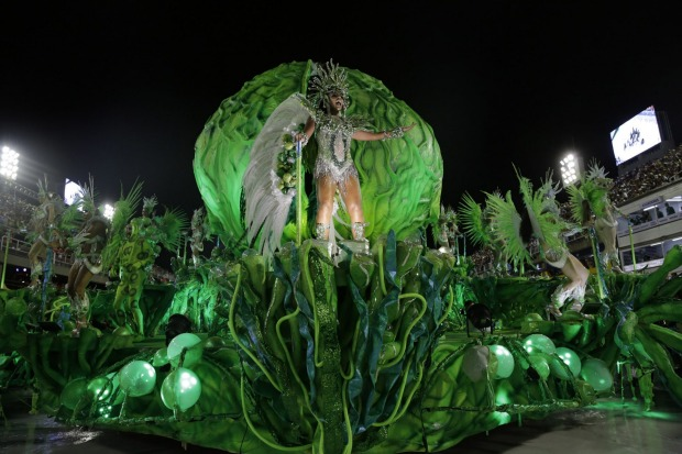 Performers from the Imperio Serrano samba school parade during Carnival celebrations at the sambadrome in Rio de ...