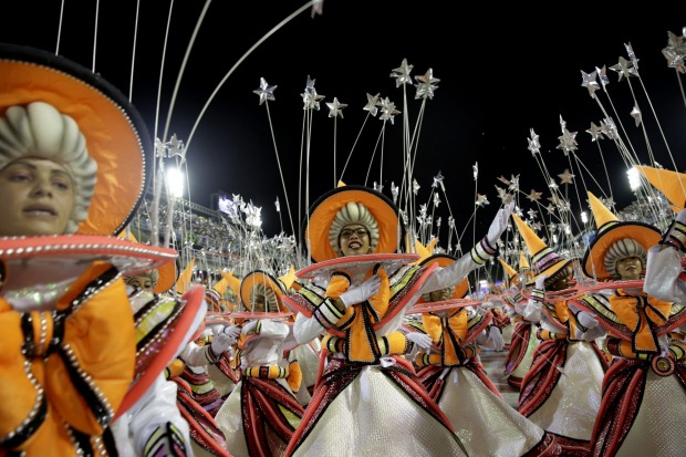 A performer from the Viradouro samba school parades during Carnival celebrations at the sambadrome in Rio de Janeiro, Brazil.
