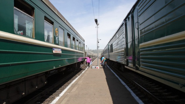 Train carriages wait for a diesel engine at the Russian border port of Naushki, Siberia.