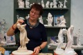 An artist demonstrates her craft at the Meissen porcelain museum.