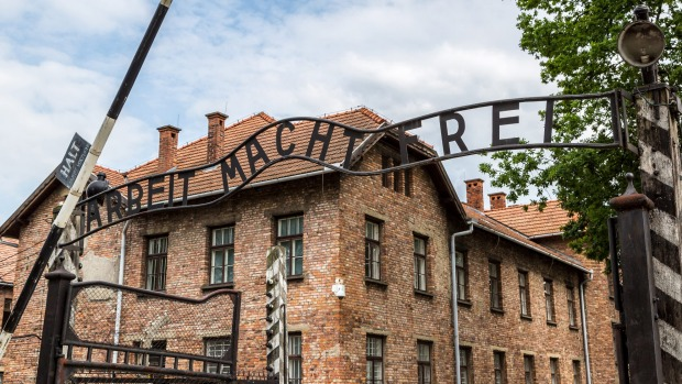 The entrance gate to former concentration and extermination camp Auschwitz-Birkenau.