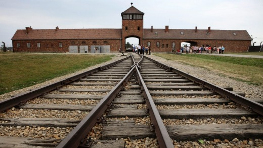 Railway tracks lead into the  Auschwitz death camp.