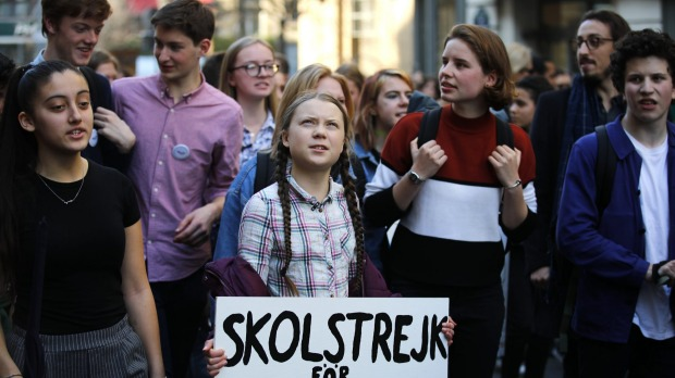 Swedish teenager Greta Thunberg leading a march of thousands of French students through Paris in February. She got there ...