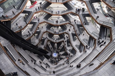 "Visitors to the ""Vessel"" climb its staircases on its opening day at Hudson Yards in New York. Hudson Yards, a $35 ..."