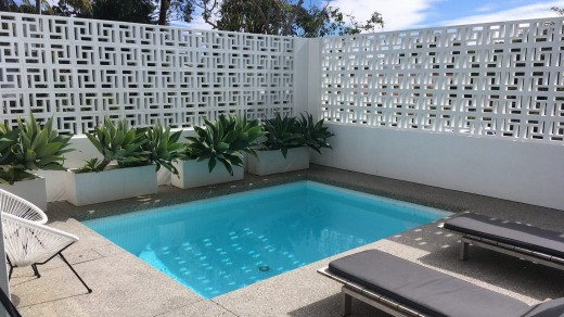 Breeze blocks are back in fashion and the pool here has them.