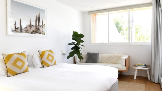 The Sun suite at Bask & Stow is decorated in a mid-century modern style.
