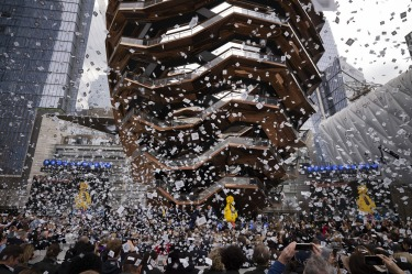 "Confetti swirls around ""Vessel"" on its opening day at Hudson Yards in New York. Hudson Yards, a $35 billion urban ..."