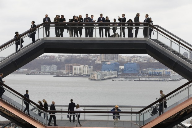 "Visitors to ""Vessel"" climb its staircases on its opening day at Hudson Yards in New York. Hudson Yards, a $25 billion ..."