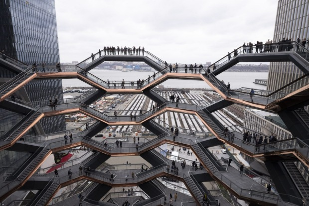 "Visitors to ""Vessel"" climb its staircases on its opening day at Hudson Yards in New York. Hudson Yards, a $35 billion ..."