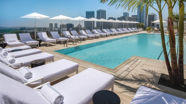 The rooftop swimming pool is expansive and its guests-only environment serene.