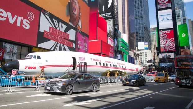 A vintage plane that went from flying passengers in the 1950s to running drugs in the 1970s visited Times Square before ...