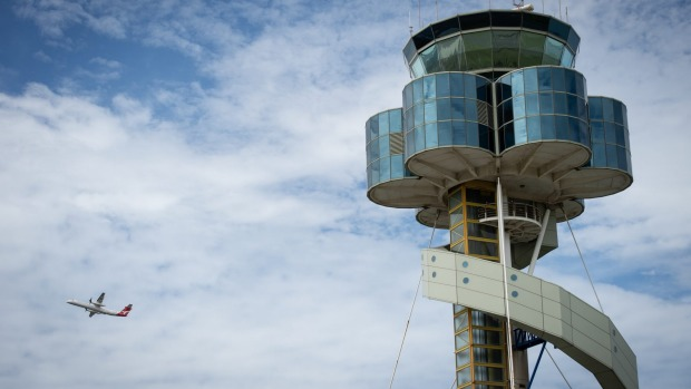 The tower at Sydney Airport.  Airservices Australia has proposed relocating as many as 65 air traffic controllers from ...